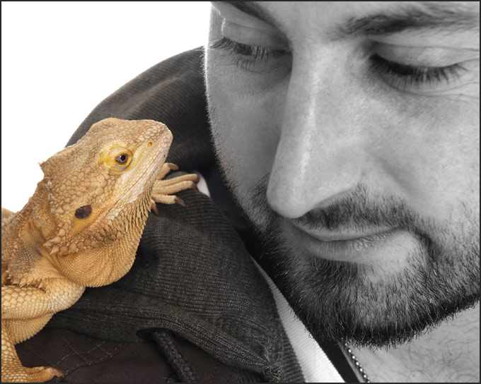 Carl and his Bearded Dragon Lucy eye to eye